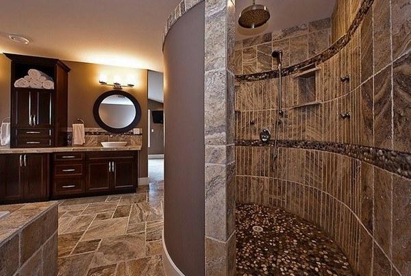 a modern doorless shower in the bathroom