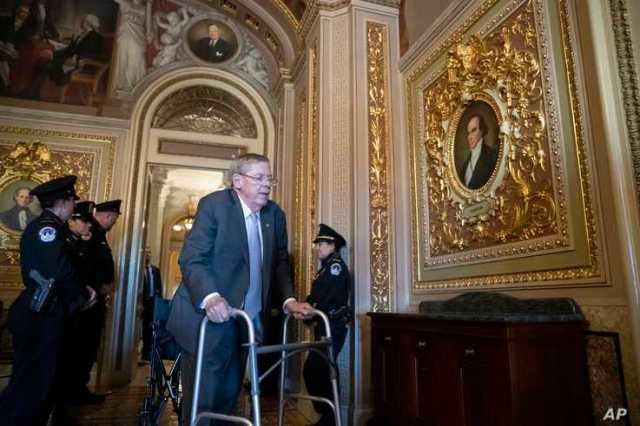 Sen. Johnny Isakson, R-Ga., walks to the Senate floor to give his farewell speech Tuesday, Dec. 3, 2019 in Washington, on…