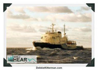 Large ice-breaker ship sailing in open sea