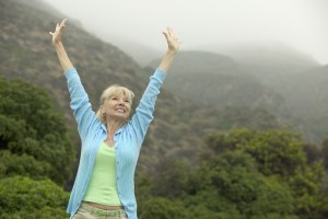 Excited Woman Raising Arms