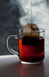 tea bag and a glass cup with smoke