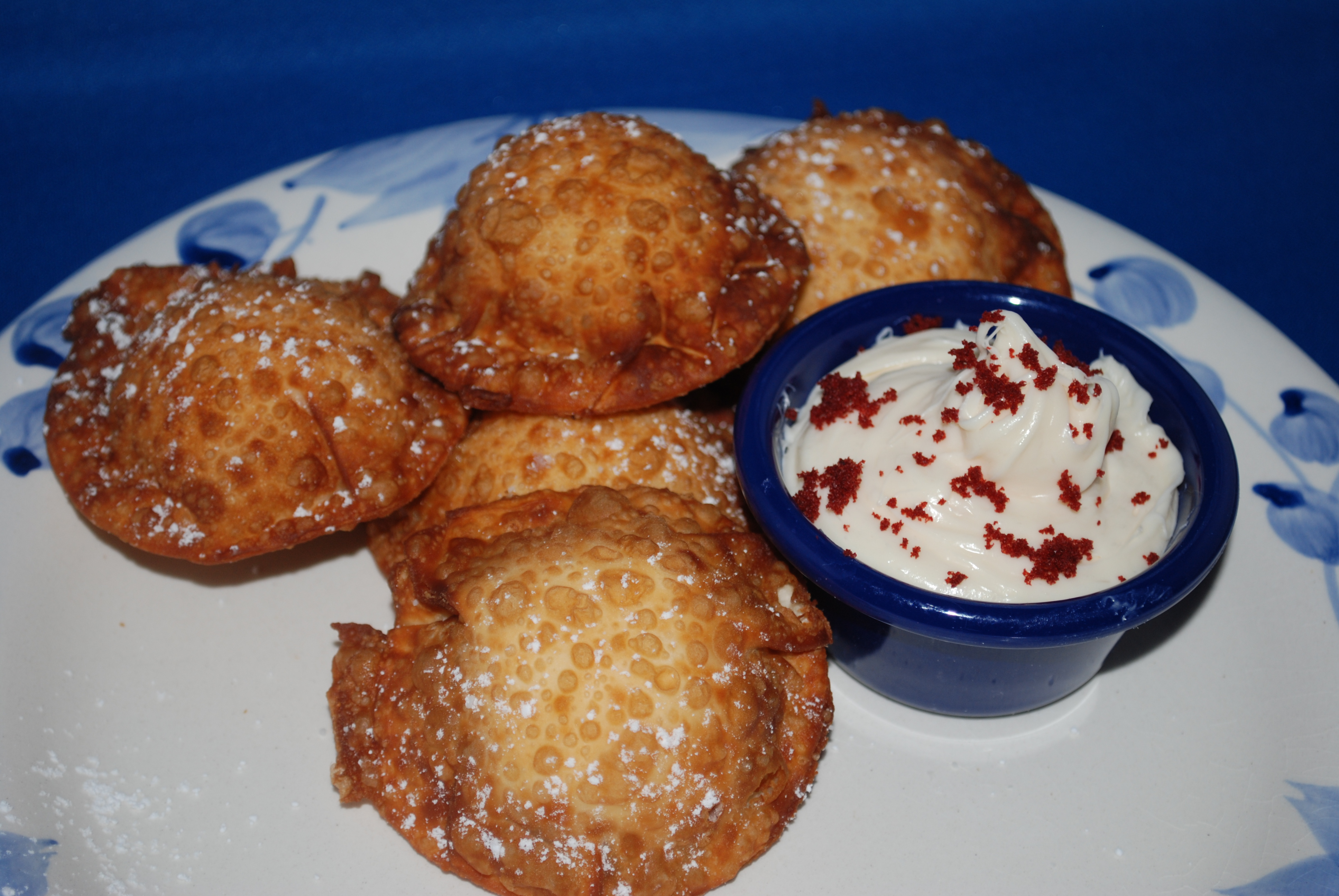Red Velvet Cheesecake Wontons with cream cheese icing for dipping!