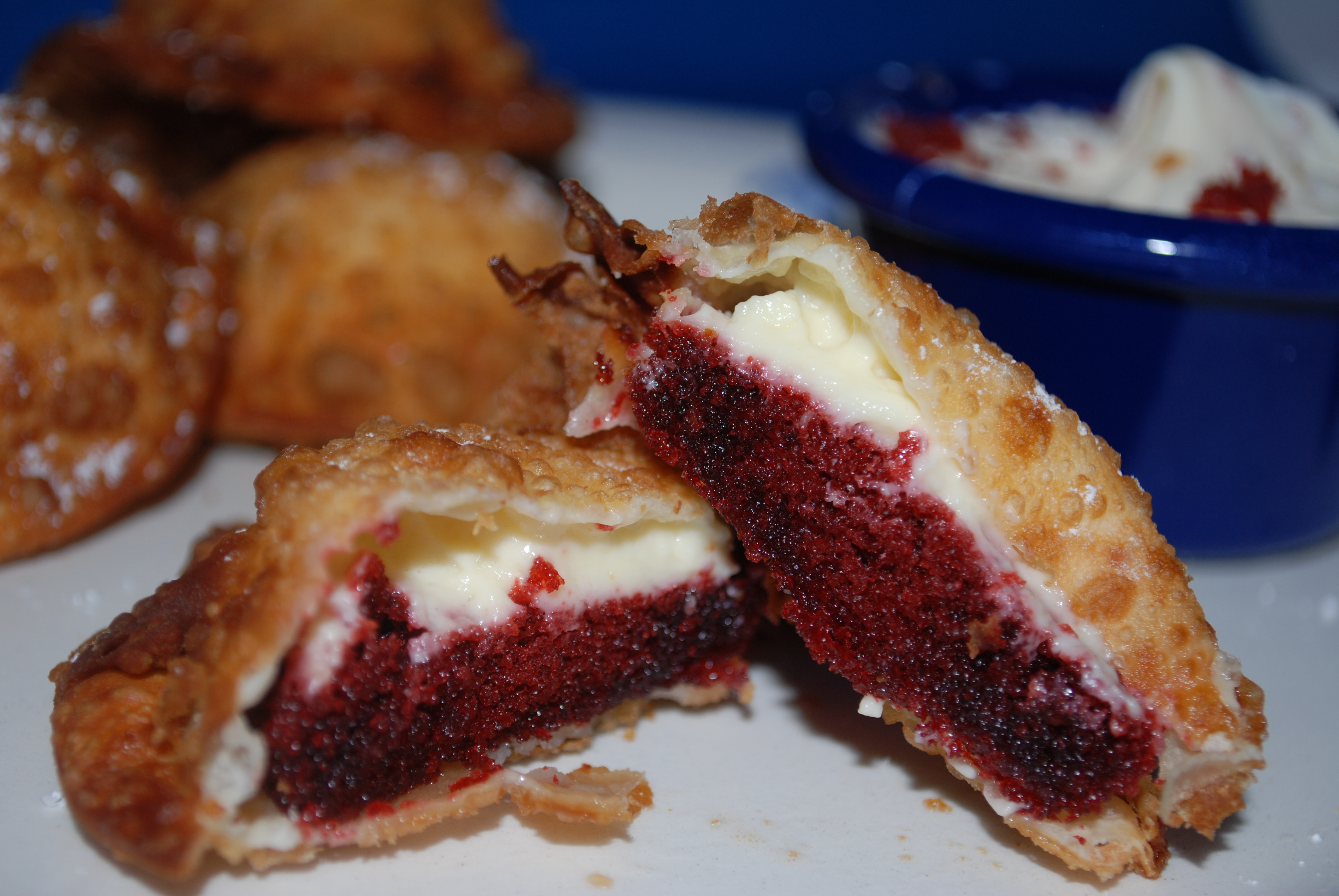 Red velvet cake, cheesecake filling in a wonton with cream cheese icing for dipping!
