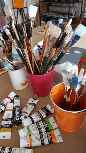 Paint and Brushes in the art studio