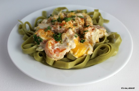 Shrimp and Scallops in a Creamy Sauce served over pasta
