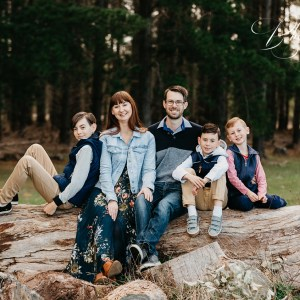 family sitting on a log adelaide family photography