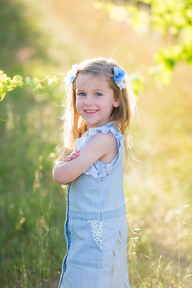little girl standing in vineyards for a family photo session