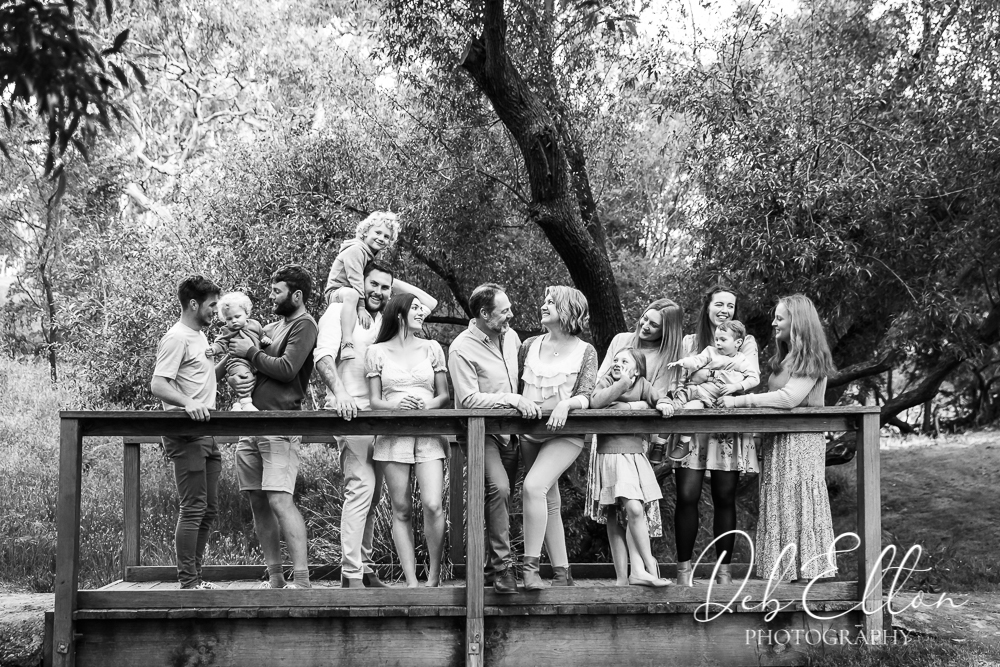 generational family on a bridge