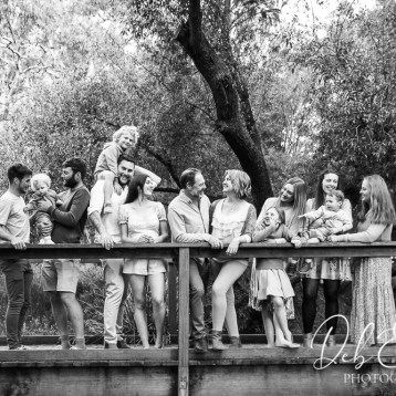 generational family on a bridge
