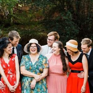 family standing on bridge laughing
