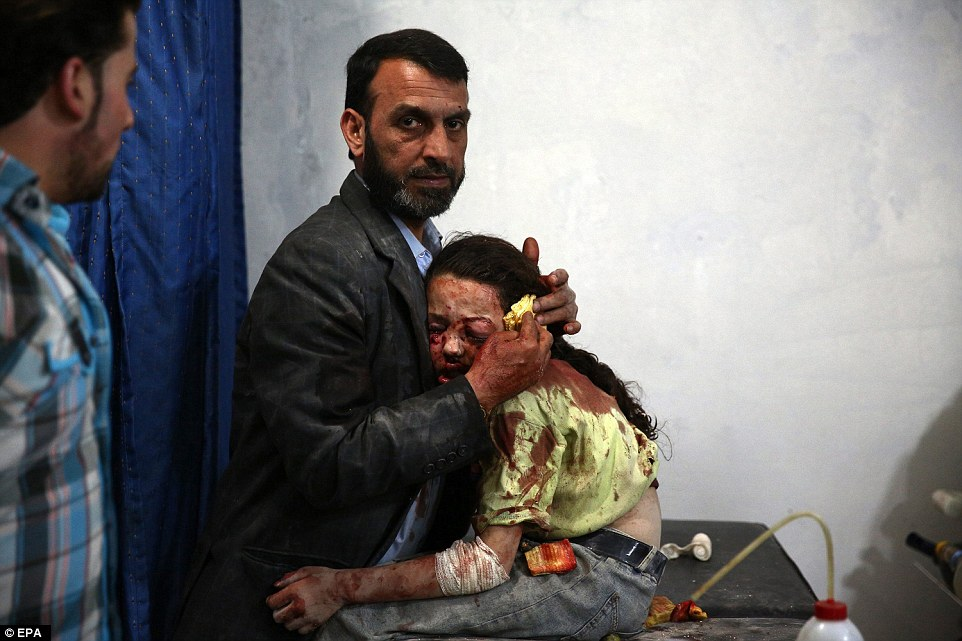 31571ECE00000578-3452659-The_picture_shows_a_wounded_Syrian_girl_holding_on_to_a_relative-a-31_1455810915466