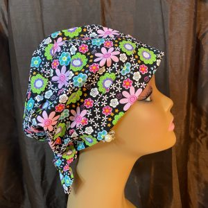 colorful flowers and black scrub hat