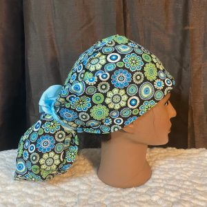 ponytail scrubhat with blue and green flowers
