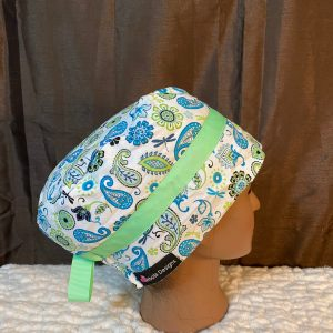 Blue and white scrub hat with green lace trim