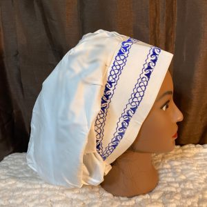 white bouffant scrub hat with blue embroidery
