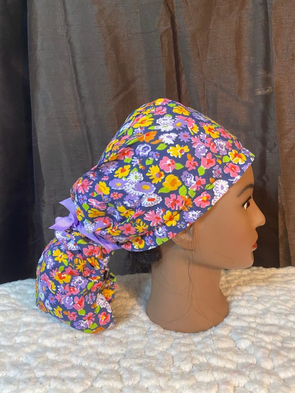 Ponytail scrub hat with colorful flowers
