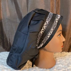 black bouffant scrub hat with white embroidery