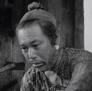 The woodcutter, played by Takashi Shimura. The entire movie begins and ends with him on screen. This was one of the most interesting characters in the movie.