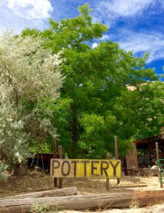 "Photo of ""Pottery"" sign and trees"