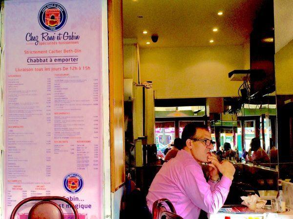 Photo of man with pink shirt inside restaurant Chez René et Gabin