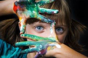 Shutterstock image of a girl fingerpainting
