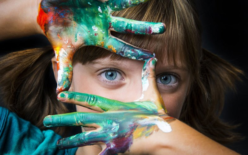 Shutterstock image of a girl fingerpainting