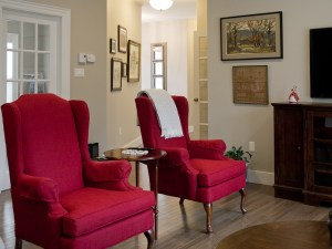 re-upholstered antiques with on-trend fabrics - bold red