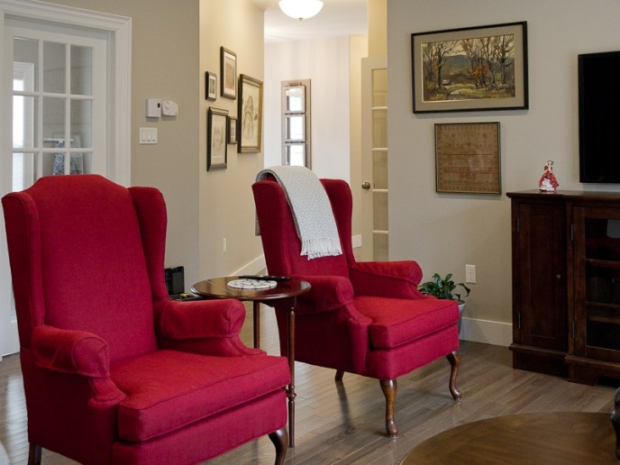 re-upholstered antique wing chairs - bold red