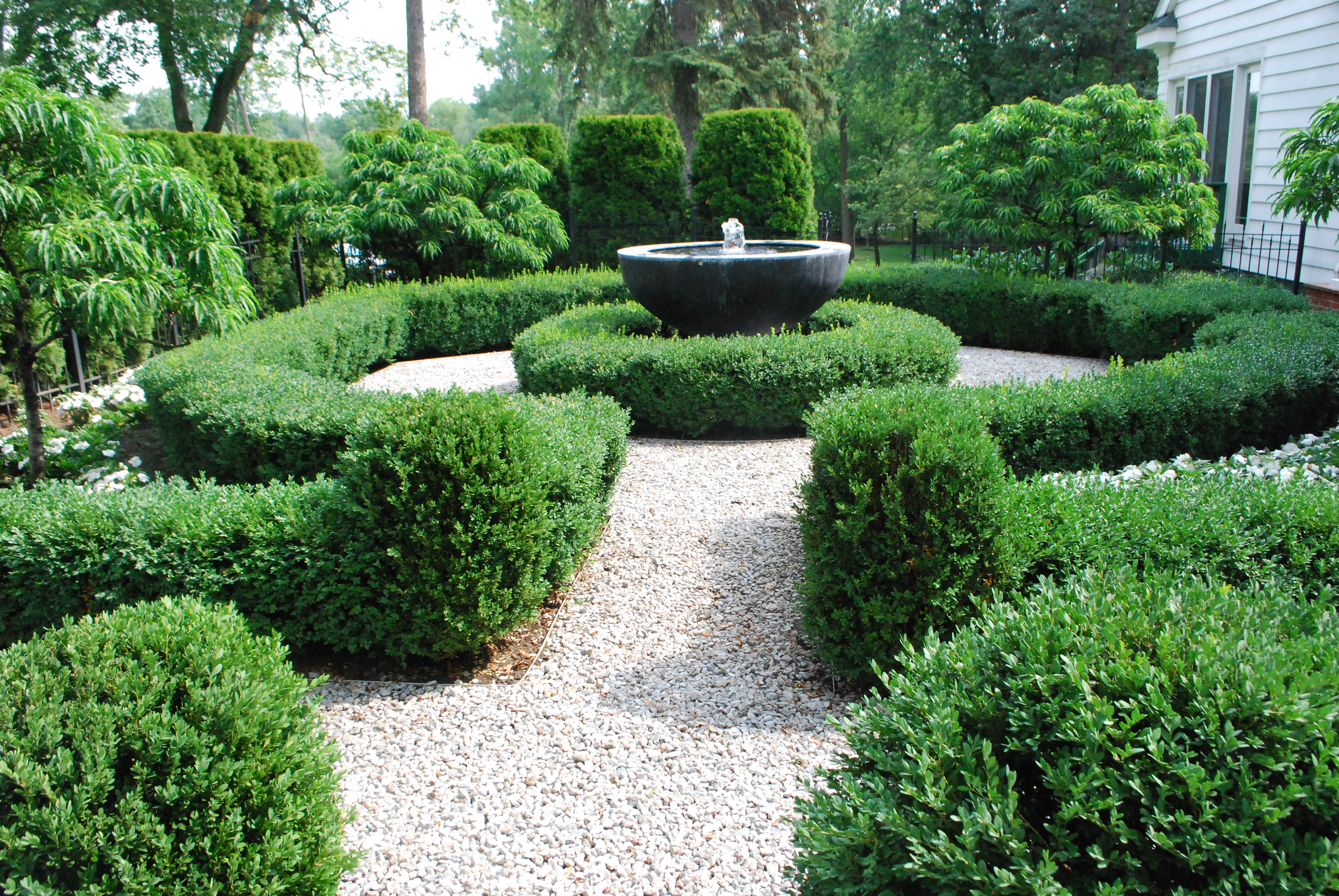 Image result for fountain in garden with circular hedges