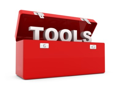 A red tool box with the letters TOOLS.