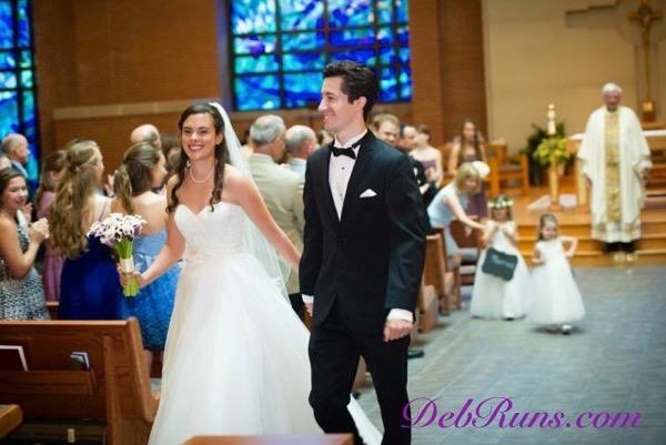 WeddingJulieJosephWalkingDownAisleSignature