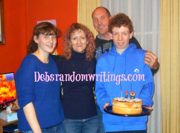 Gregs holding his eighteenth birthday cake