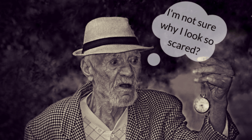 old man looking at a watch