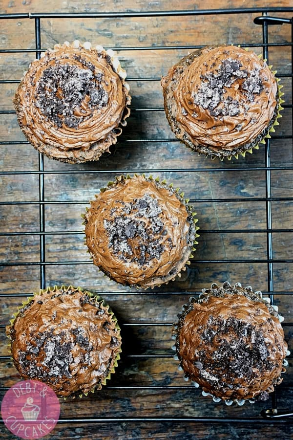 chocolate cupcake with chocolate buttercream on wire cooling rack