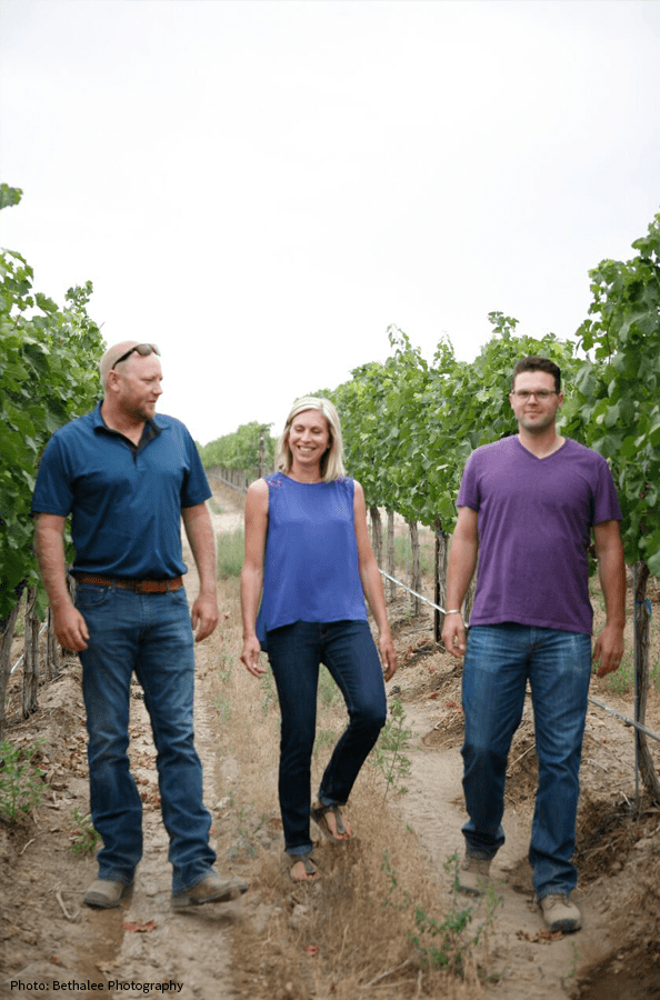 Josh & Lisa Lawrence and Aryn Morell in the vineyard