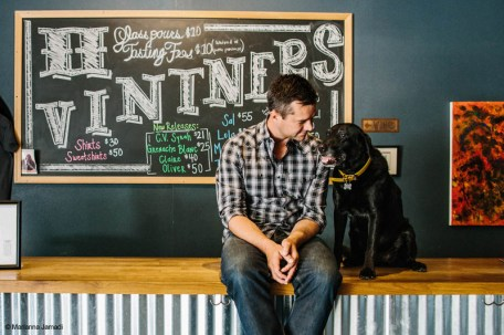Morgan Lee and Lola, the black lab at Two Vintners