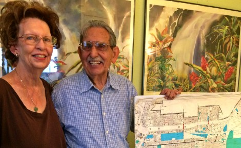 Jo Ann and Gil Murillo with a map of the neighborhood