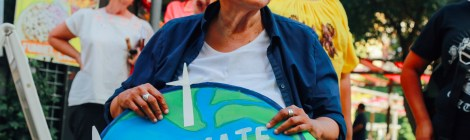 San Antonio artist Mary Agnes Rodriguez represents at historic climate justice rally last summer during the city's mayor runoff election. Image: Vanessa Ramos