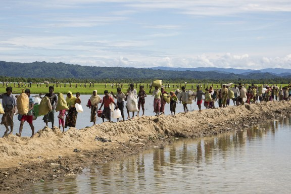 Rohingya families arrive at a UNHCR transit centre