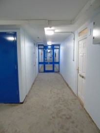 A corridor minus the flooring.