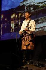 "Ngawang Lodup sings the popular Tibetan song ""Aku Pema"" using an electro-mandolin"