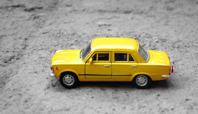 yellow toy car illustrating how human+AI collaboration works to operate a semiautonomous vehicle