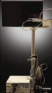 FIGURE 1. The dental videoscope enables clinicians to view the subgingival environment more accurately than is possible with the dental endoscope, surgical telescopes (loupes), or surgical microscope.
