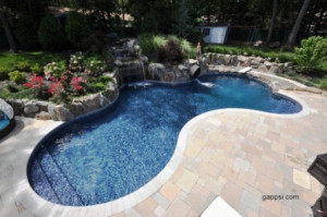 Travertine Surrounding a Free Form Pool Manorhaven NY 11050  Deck and Patio Natural Stones