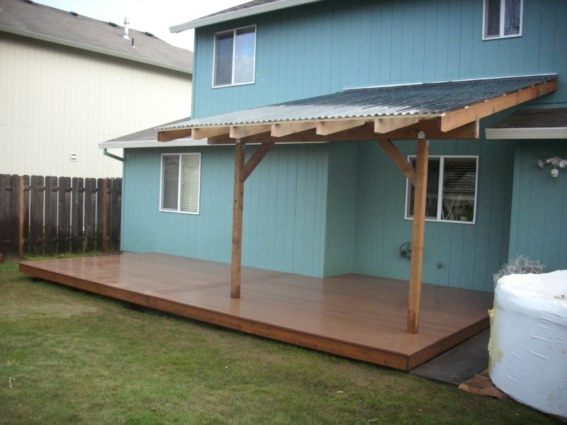 Composite deck with patio cover deck masters llc for Composite porch decking