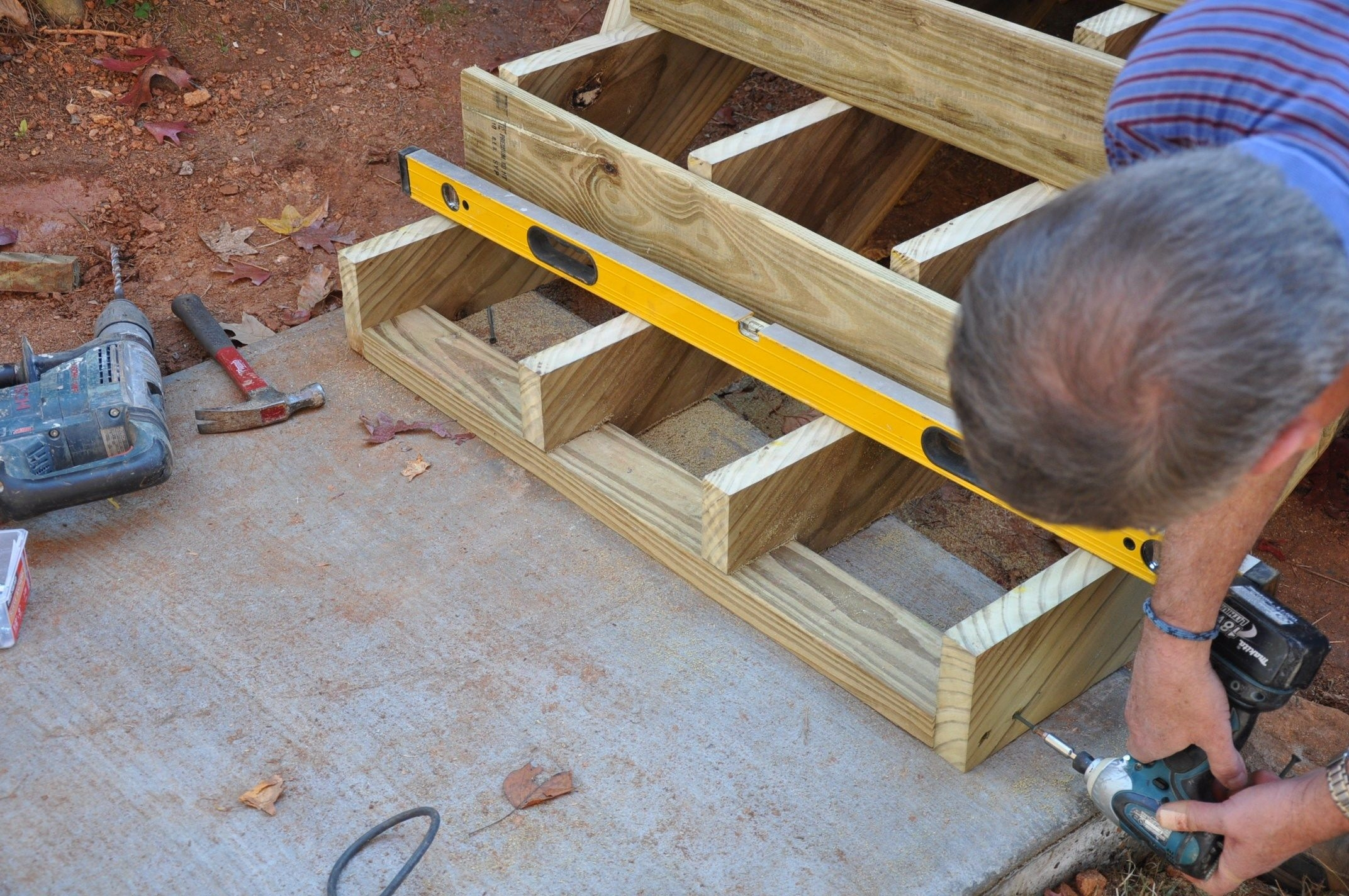 How To Anchor Deck Stairs To Concrete Decks Com | Repairing Outdoor Wooden Steps | Stair Stringer | Concrete Slab | Deck Stairs | Concrete Porch | Deck