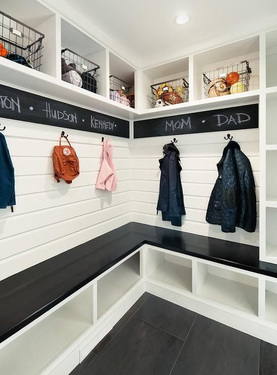 This is a gorgeous DIY mudroom (or foyer) idea - love the chalkboard wrapping around it.  The cubbies are great for keeping things organized - I'd throw some pretty baskets in the cubbies at the bottom to declutter and keep it looking neat and tidy
