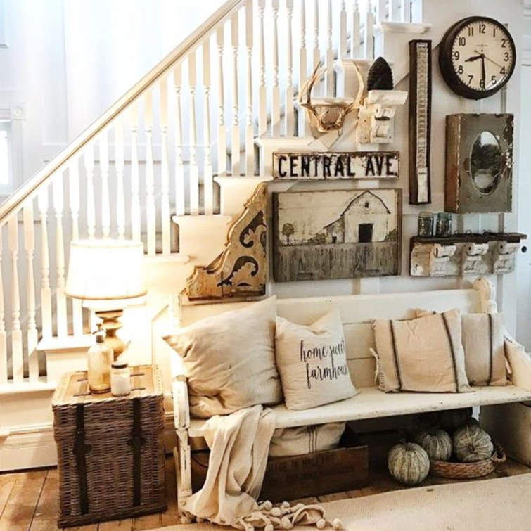 Love this farmhouse foyer idea - unique and eclectic gallery wall with interesting rustic decor items, a wood farmhouse bench that looks upcycled or reclaimed and repurposed to use as a furniture piece.  Great farmhouse entry way decorating #gallerywallideas #decoratingideas #livingroomideas #diyhomedecor #homedecorideas