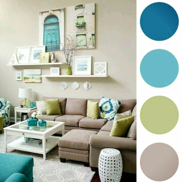 Gorgeous gallery wall idea with pops of color and floating shelves in this neutral living room #gallerywallideas #decoratingideas #livingroomideas #diyhomedecor #homedecorideas