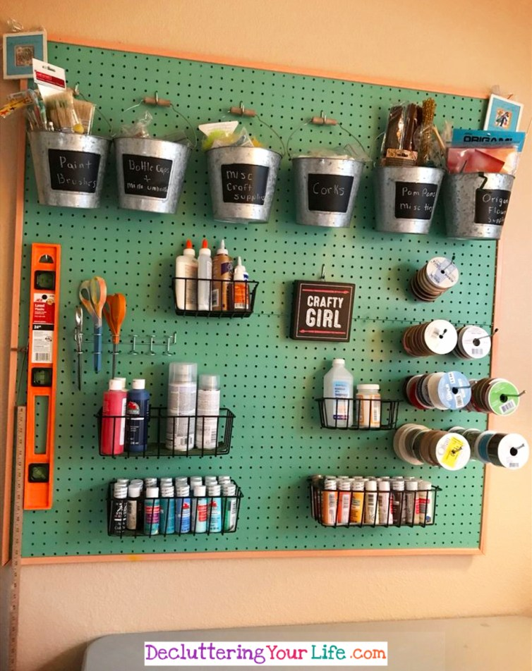 Craft Room Wall - This simple pegboard makes it SO easy to keep my craft supplies organized - Craft Room Organizing Ideas #gettingorganized #goals #organizationideasforthehome